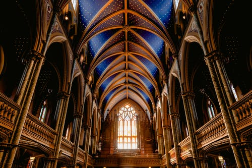 Interior of old Roman Catholic cathedral with wooden arched details