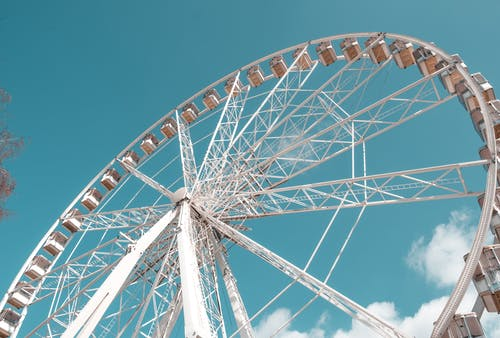 Low-Angle Shot of a White Ferris Wheel