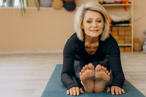 Elderly Woman Doing Yoga Exercise