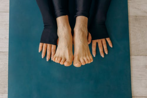 Person in Black Pants Showing Feet