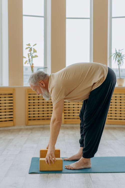 Man in Gray T-shirt and Black Pants Doing Push Up