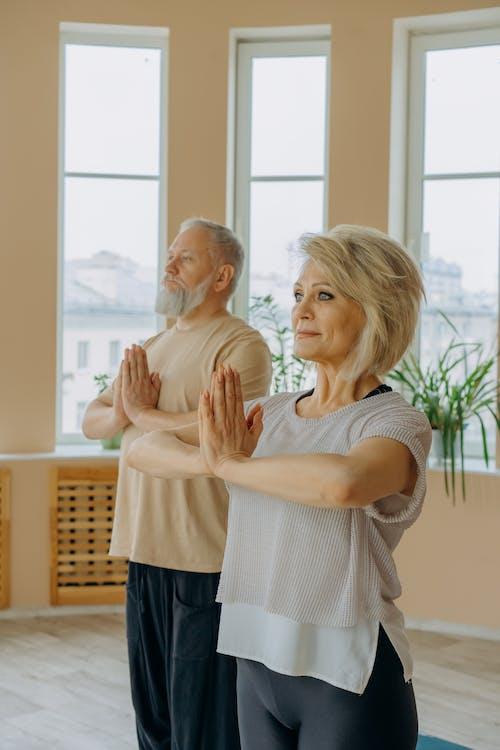 Elderly Couple Meditating
