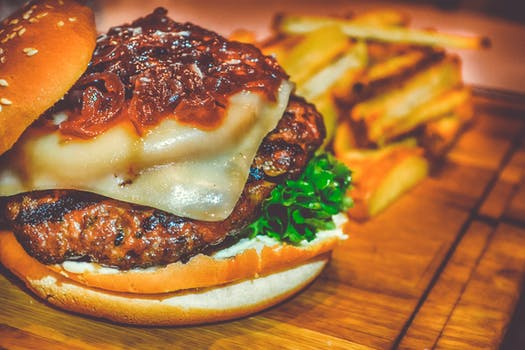 Selective Focus of Ham Burger on Wooden Surface Photo