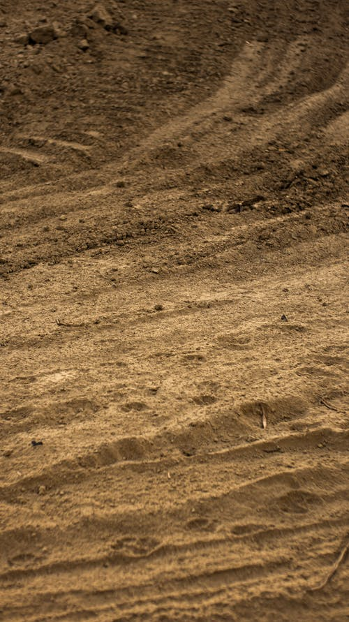 Sandy ground in countryside in daytime