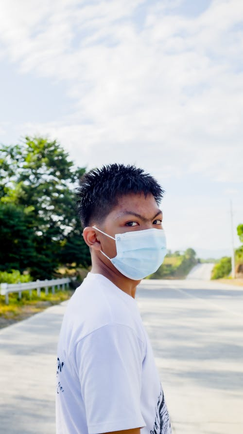 Ethnic man in protective medical mask