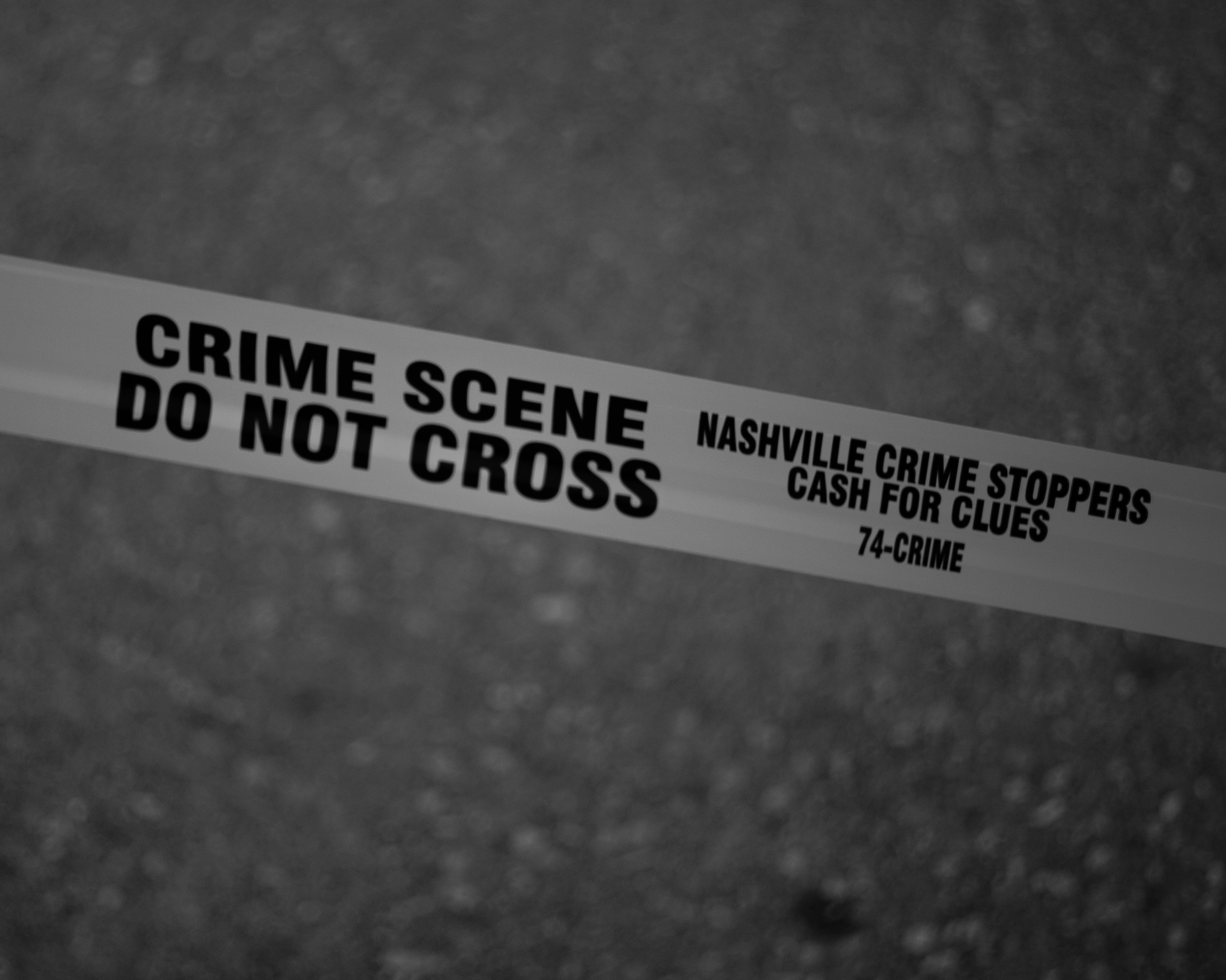 Grayscale Photo of Crime Scene Do Not Cross Tape