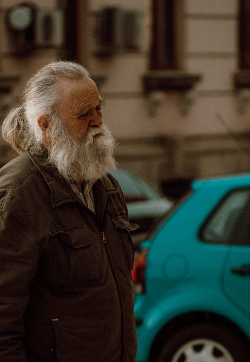 Selective Focus Photo of an Elderly Man with a Gray Beard