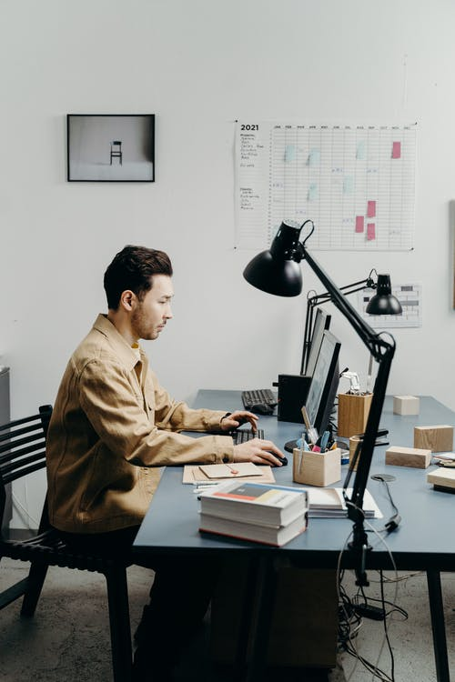 A Man Scrolling on the Computer