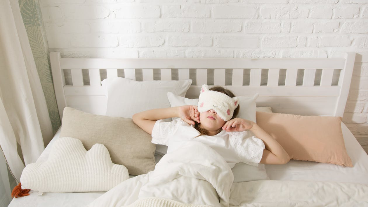 Person Lying Down wearing a Sleep Mask