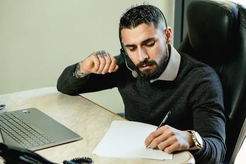Man in Black Sweater Wearing Black Headphones