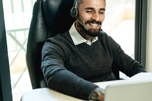 Man in Black Sweater Wearing White Headphones