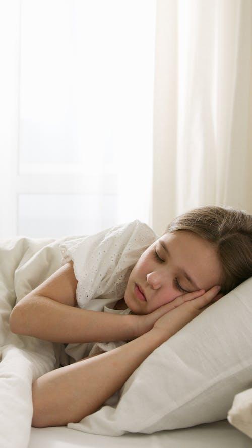 Kid Sleeping on Bed