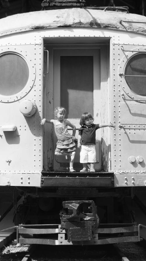 Free stock photo of black and white, bored, boy, caboose