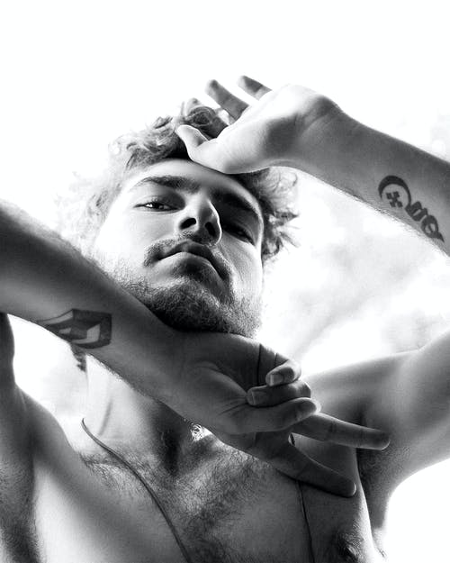 Grayscale Photo of Topless Man