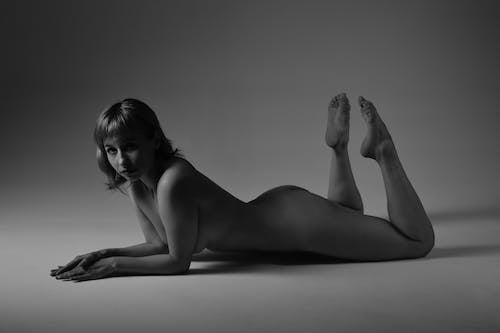 Naked woman lying in studio
