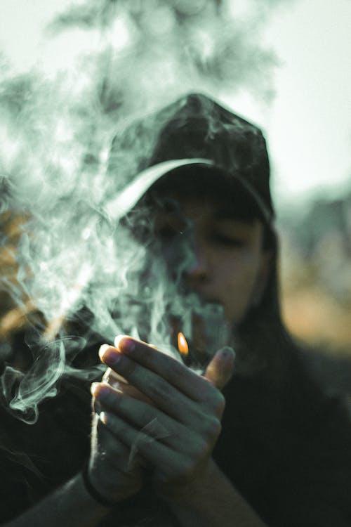 Man smoking cigarette on street