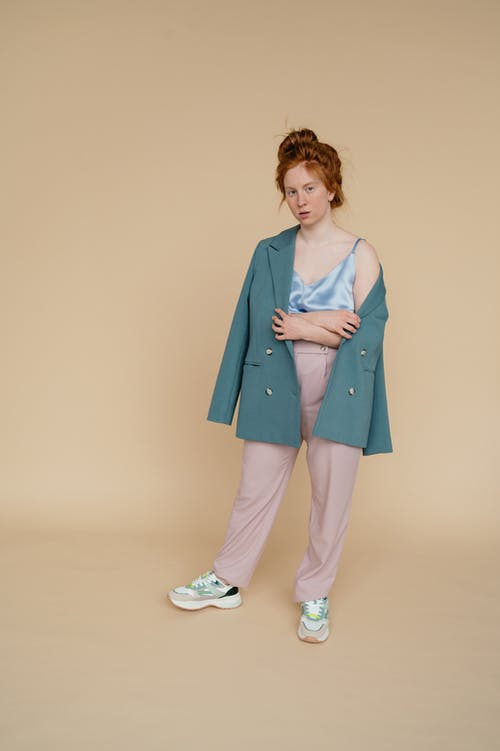 Woman Wearing Turquoise Colored Blazer