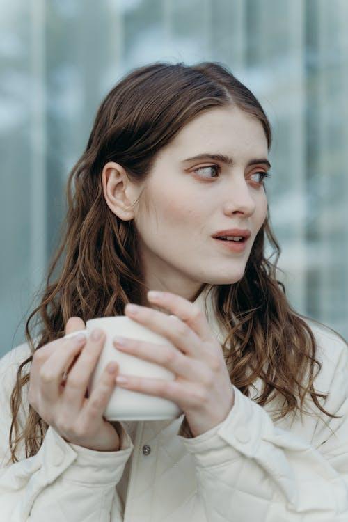 Woman Holding White Ceramic Mug