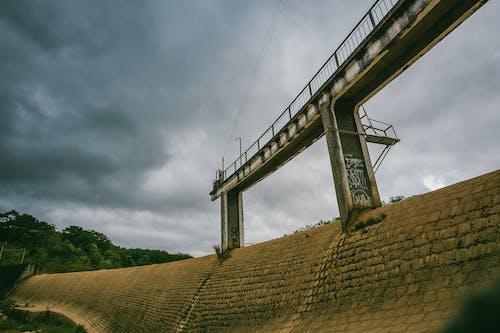 White Concrete Dam With Bridge