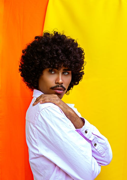 Stylish ethnic model with Afro hairstyle and mustache