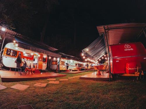 Tourists sitting near van at night
