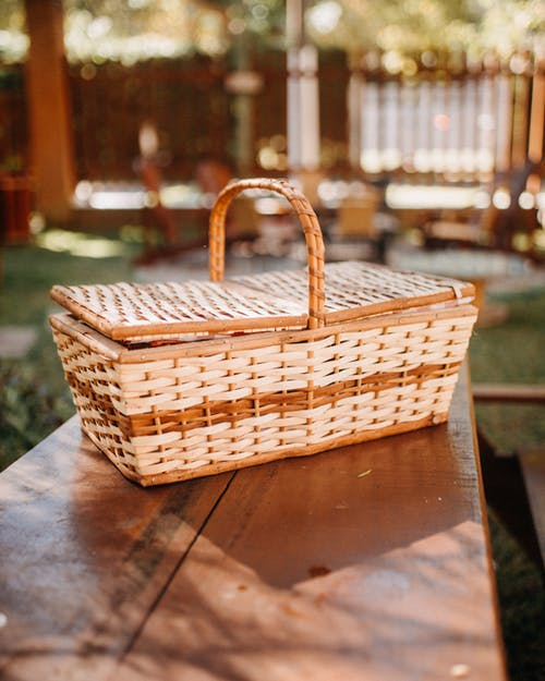 Brown Woven Basket on Brown Wooden Table