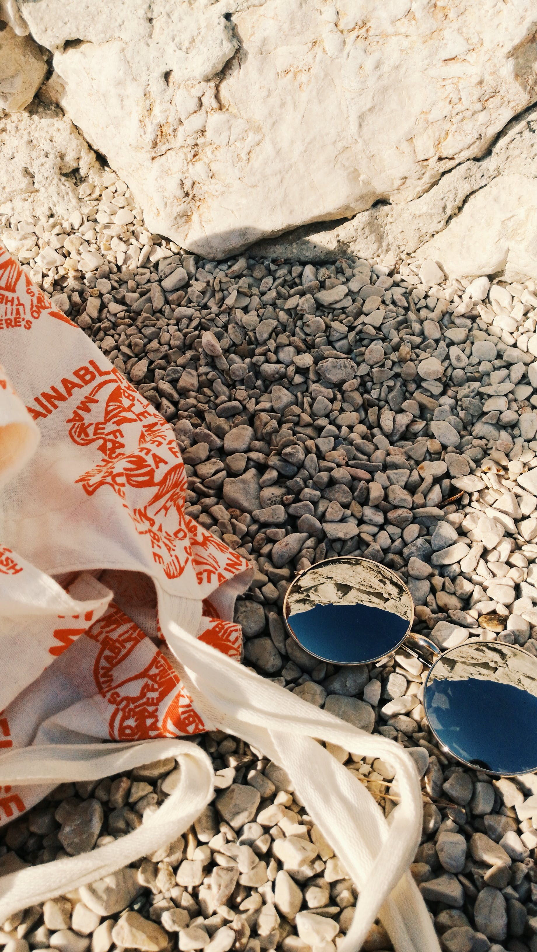 Black Sunglasses on Pebbles Outdoors