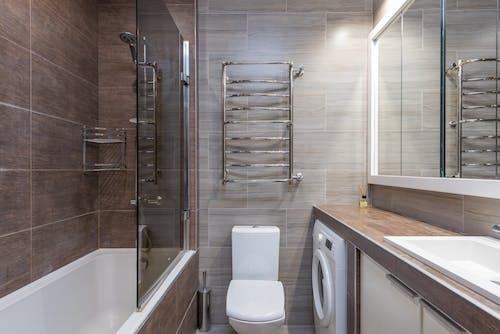 Contemporary bathroom interior with bathtub and toilet bowl