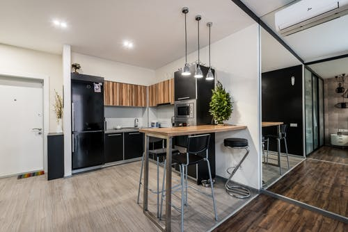Modern kitchen in apartment with table