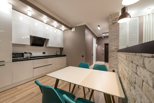 Stylish kitchen with table and kitchenware
