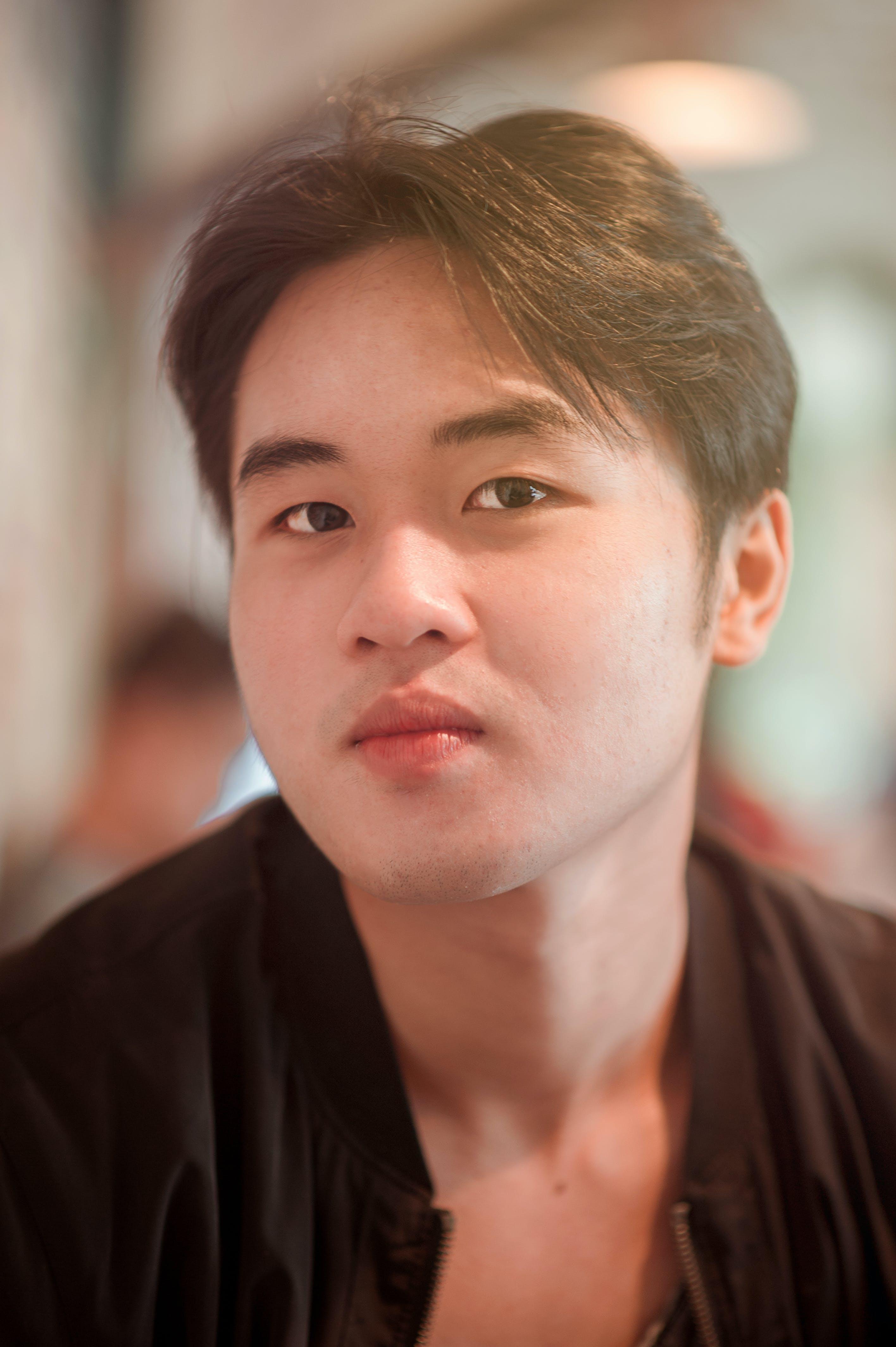 Close Up Photo of Man Wearing Black Shirt