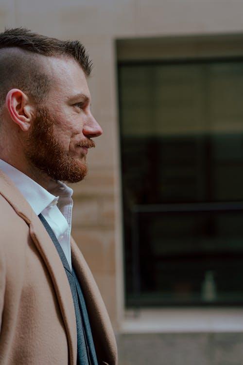 Man in Brown Suit Jacket