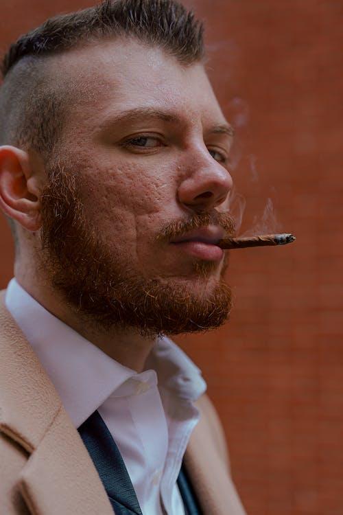 Man in White Dress Shirt Smoking