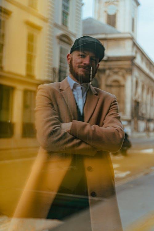 Man in Brown Coat Standing on Sidewalk