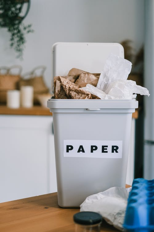 Plastic container for paper on table