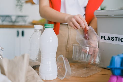 Woman sorting out plastic wastes at home