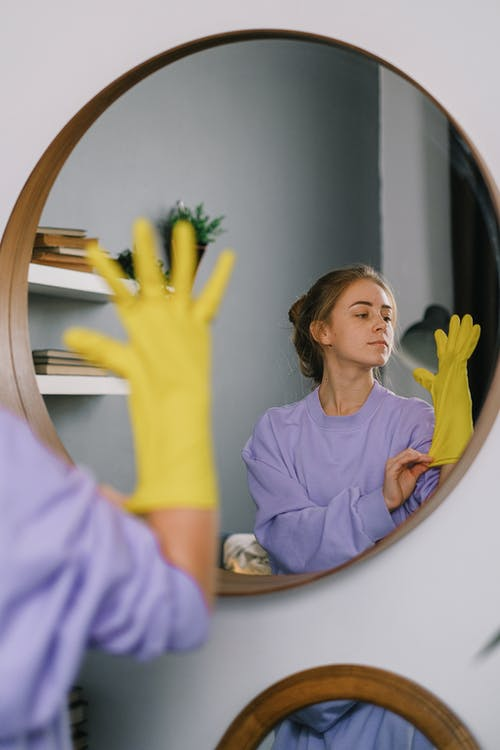 Woman's Reflection on a Wall Mirror
