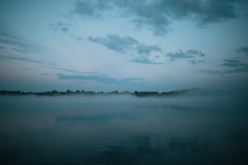 A Lake Surface Covered with Fog