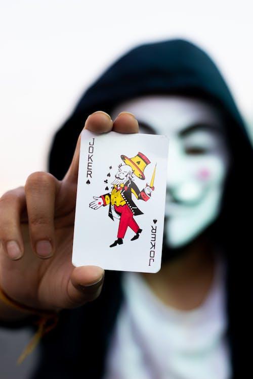 Woman Holding Joker Playing Card