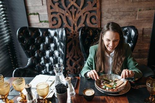 A Woman Having Breakfast in a Restaurant