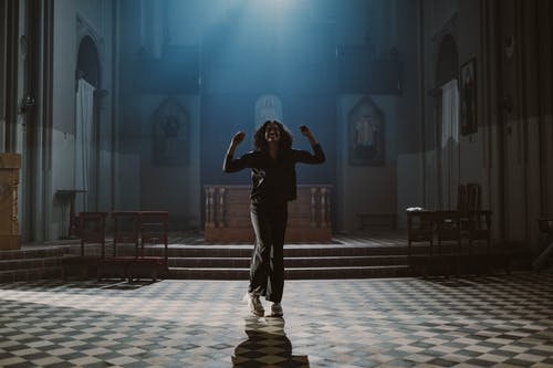 Woman Dancing Inside the Church