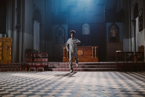 Man Dancing in Church