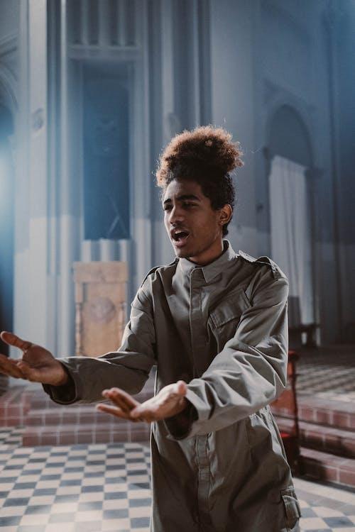 Man Singing in Church