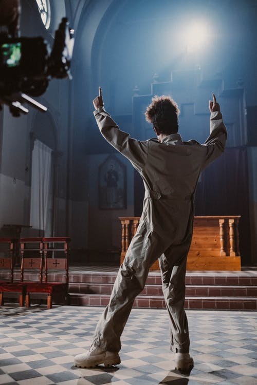 Filming Man Singing and Dancing in Church