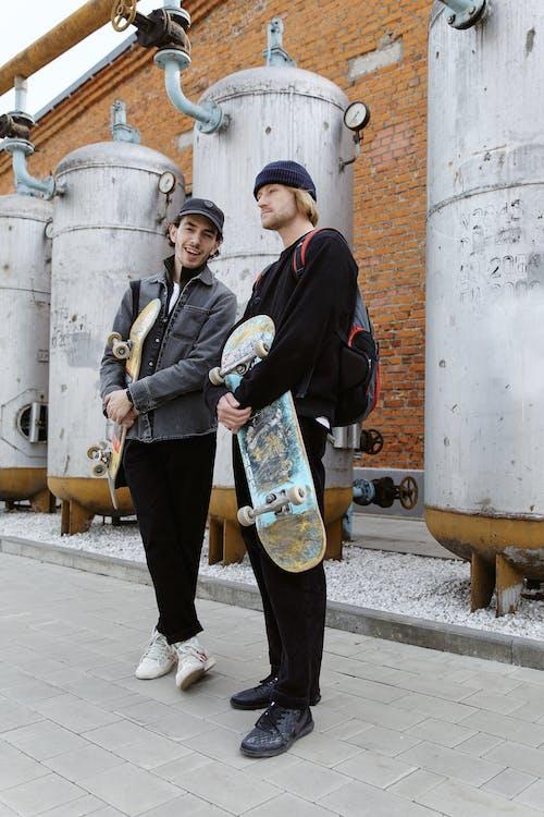Men Holding their Skateboards