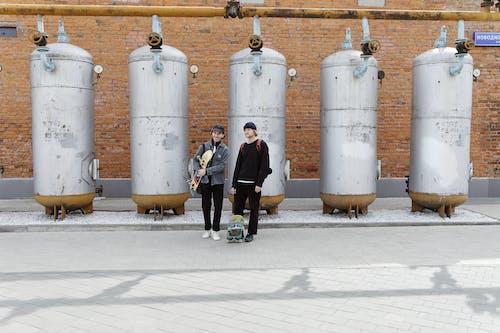 Men Standing on the Concrete Pavement