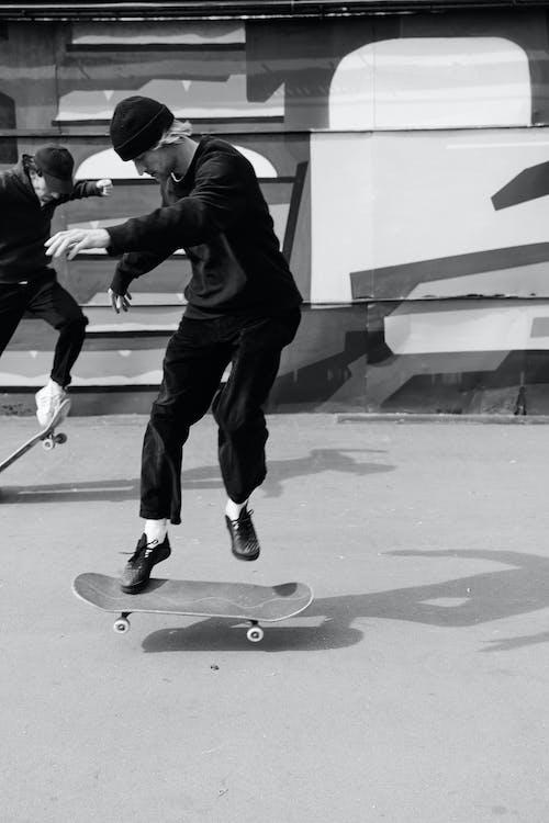 Men Riding a Skateboard