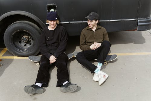 Two Men Leaning on a Van
