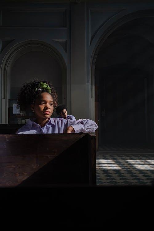 Woman Sitting Inside the Church