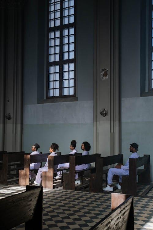 People Sitting on Church Pews